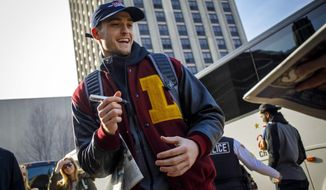 Loyola guard Clayton Custer signs autographs as fans welcome the Ramblers back to campus on Sunday, March 18, 2018, in Chicago, after the team advanced to the Sweet 16 of the NCAA Tournament in their first appearance since 1985. (Brian Cassella/Chicago Tribune via AP)