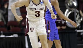 Texas A&M's Chennedy Carter (3) reacts after making the winning basket against DePaul during the closing seconds of second half of a second-round game against DePaul in the NCAA women's college basketball tournament in College Station, Texas, Sunday, March 18, 2018. (AP Photo/David J. Phillip)