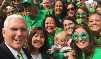 In this March 17, 2018 photo provided by Shannon Lennon, bottom right, Vice President Mike Pence, bottom left, poses for a selfie with a group during a St. Patrick's Day parade in Savannah, Ga. (Vice President MikePence/Shannon Lennon via AP)