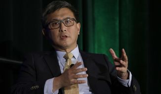 FILE - In this March 8, 2018, file photo, California gubernatorial candidate, state Treasurer John Chiang, a Democrat, speaks at a conference in Sacramento, Calif. Chiang will be joined family members of people who died in a 2015 shooting in San Bernardino, Calf., at a meeting of the California Public Employees Retirement System, Monday, March 19, 2018, calling on the nation's largest public pension fund to stop investing in companies that sell assault-style weapons banned for ownership in California and devices that allow guns to fire more rapidly. (AP Photo/Rich Pedroncelli, File)