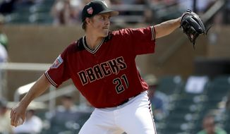 Arizona Diamondbacks starting pitcher Zack Greinke throws to a Cincinnati Reds batter during the first inning of a spring training baseball game in Scottsdale, Ariz., Wednesday, March 14, 2018. (AP Photo/Chris Carlson)