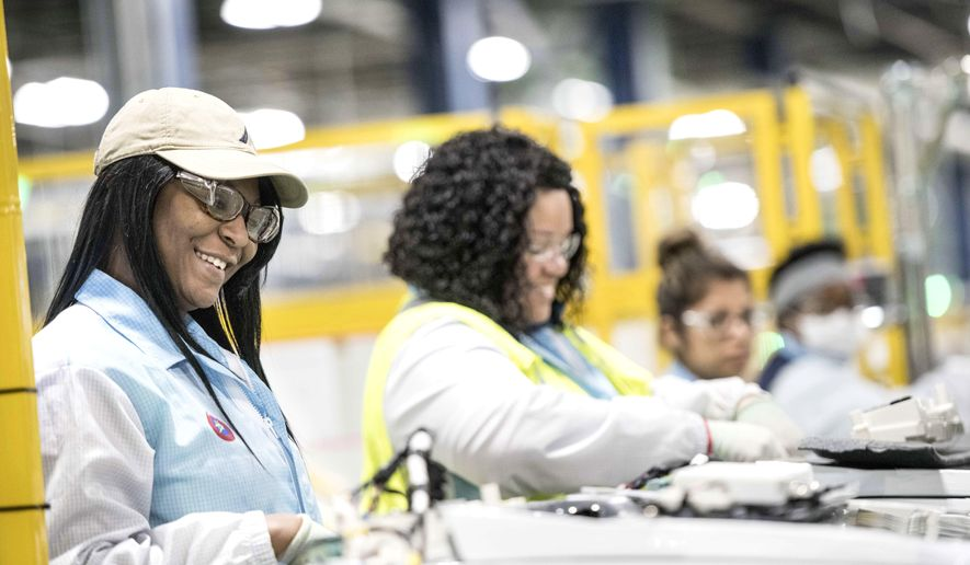In this Friday, March 16, 2018 photo, Niesha Samuel works on the factory floor at the Samsung washing machine facility, in Newberry, S.C. The appliance manufacturer on Monday, March 19 announced the expansion of its production footprint in South Carolina, making progress on a plan to create nearly 1,000 by 2020.   (AP Photo/Sean Rayford)