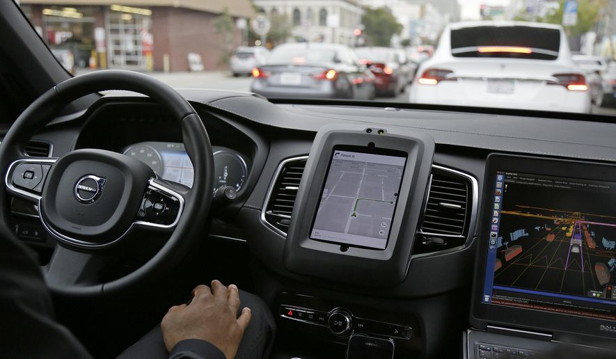 In this Dec. 13, 2016 file photo, an Uber driverless car waits in traffic during a test drive in San Francisco.  (AP Photo/Eric Risberg, File) **FILE**