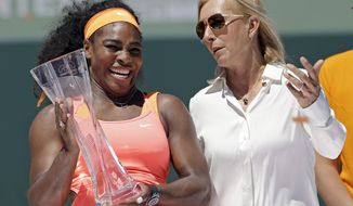 "FILE - This is a Saturday, April 4, 2015, file photo of former tennis star Martina Navratilova, right,  as she poses with Serena Williams, after Williams won the women's final match at the Miami Open tennis tournament, in Key Biscayne, Fla. Martina Navratilova says she is ""angry"" and feels let down by the BBC after learning that John McEnroe gets paid at least 10 times more than her for their broadcasting roles at Wimbledon. McEnroe earns between 150,000-199,999 pounds ($210,000-280,000) for working at Wimbledon while Navratilova says she gets paid 15,000 pounds ($21,000). The BBC says Navratilova appears on fewer broadcasts and is on a different type of contract than McEnroe. (AP Photo/Alan Diaz/File)"