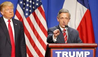 Pastor Robert Jeffress appears with then-candidate Donald Trump at a presidential event in this file photo. President Trump said on April 10, 2020, that he would watch Mr. Jeffress's livestreamed worship service on Easter Sunday, April 12. (Associated Press) **FILE**