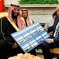 President Trump shows a chart highlighting arms sales to Saudi Arabia during a meeting with Saudi Crown Prince Mohammed bin Salman on Tuesday. (ASSOCIATED PRESS)
