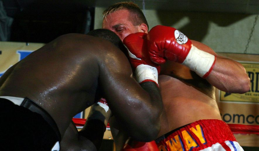 ** CORRECTS FROM TKO TO KNOCKOUT ** Heavyweight Hasim Rahman, left, lands a knockout punch on the jaw of Rob Calloway in the second round Thursday, June 17, 2004, at  Michael's Eighth Avenue in Glen Burnie, Md. It was the third win in a 99-day span for Rahman (38-5-1), the top-ranked contender in the World Boxing Association.(AP Photo/ Timothy Jacobsen)
