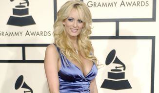 Stormy Daniels arrives at the 50th Annual Grammy Awards on Sunday, Feb. 10, 2008, in Los Angeles. (AP Photo/Chris Pizzello)