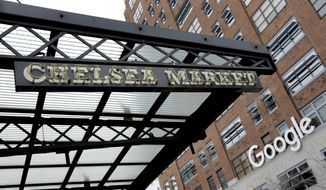 The Chelsea Market building's sign and the sign for Google's New York City headquarters, are shown in this photo, Tuesday, March 20, 2018. Google Inc. has finalized the $2.4 billion purchase of New York City's Chelsea Market building, the former Nabisco factory, on Tuesday. (AP Photo/Richard Drew)