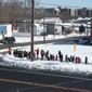 About two dozen 5 and 6-year-olds participated in a 17-minute walk outside Harbor Elementary School in New London on Wednesday. (NBC Connecticut)
