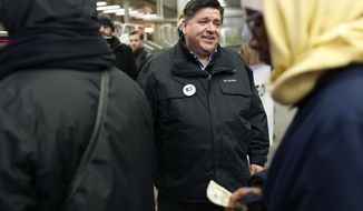 Illinois Democratic gubernatorial candidate J.B. Pritzker greets voters at the CTA Roosevelt Orange and Green Line station in Chicago on Election Day, Tuesday, March 20, 2018. (Jose M. Osorio/Chicago Tribune via AP)
