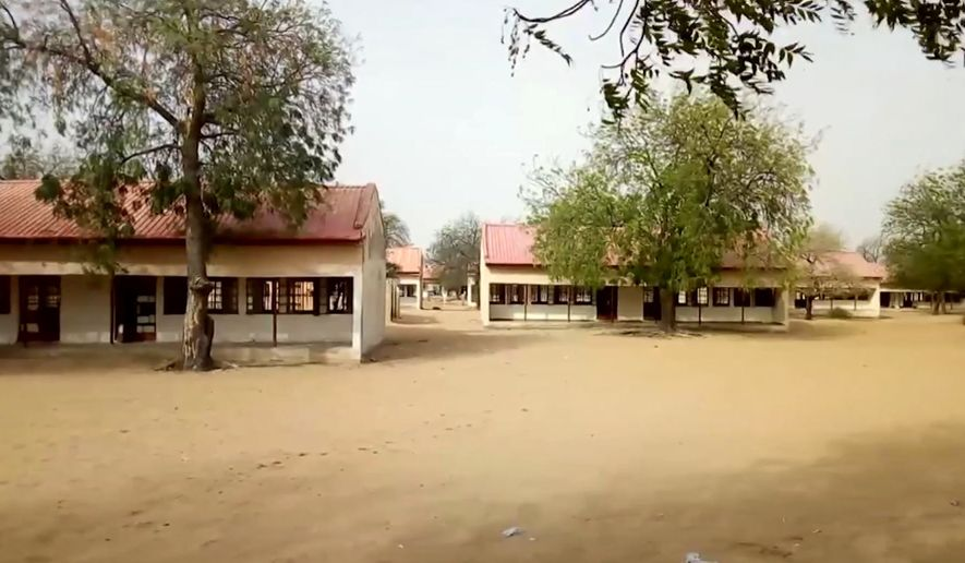 This image taken from video on Thursday Feb. 22, 2018, shows the exterior of Government Girls Science and Technical College in Dapchi, Nigeria. Nigeria's security forces failed to respond to several warnings that suspected Boko Haram extremists were on their way to a town where 110 schoolgirls were abducted last month, rights group Amnesty International said Tuesday March 20, 2018. (AP Photo, File)