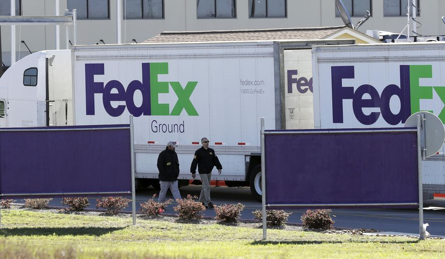 ATF agents investigate the scene at a FedEx distribution center where a package exploded, Tuesday, March 20, 2018, in Schertz, Texas. Authorities believe the package bomb is linked to the recent string of Austin bombings. (AP Photo/Eric Gay)