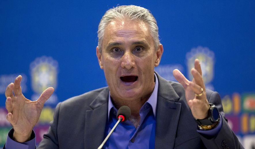Brazil's soccer coach Tite gives a press conference in Rio de Janeiro, Brazil, Monday, March 12, 2018. With Neymar out injured, Tite has brought in Real Sociedad striker Willian Jose for upcoming friendlies against Russia and Germany. (AP Photo/Silvia Izquierdo)