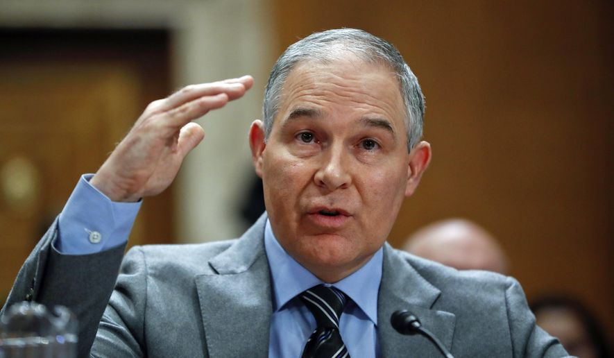 In this Jan. 30, 2018, file photo, Environmental Protection Agency administrator Scott Pruitt testifies before the Senate Environment Committee on Capitol Hill in Washington. Pruitt spent more than $120,000 in public funds last summer for a trip to Italy that included a meeting of G-7 ministers and a private tour of the Vatican. (AP Photo/Pablo Martinez Monsivais, File)