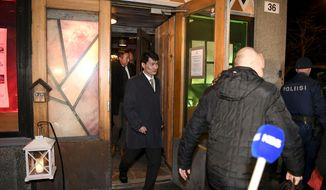 """Members of the North Korean delegation leave Saaga restaurant in Helsinki, Monday, March 19, 2018. Finland's foreign minister says representatives from North and South Korea are holding diplomatic talks in the Nordic country and describes Finland's role as a """"facilitator."""" Foreign Minister Timo Soini told the Finnish news agency STT on Monday that Finland """"is making this meeting possible"""" by helping arrange it but wouldn't mediate in the actual negotiations. (Jussi Nukari/Lehtikuva via AP)"""