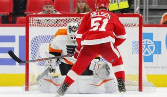 Detroit Red Wings center Frans Nielsen (51) scores the only goal of the shootout, on Philadelphia Flyers goaltender Alex Lyon (49) in an NHL hockey game Tuesday, March 20, 2018, in Detroit. Detroit won 5-4. (AP Photo/Paul Sancya)