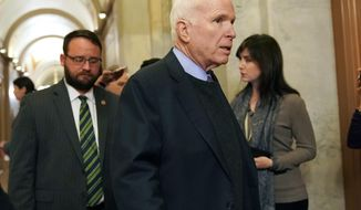 FILE - In this Nov. 13, 2017 file photo Sen. John McCain, R-Ariz., arrives on Capitol Hill in Washington. McCain continues to undergo treatment in Arizona, but Meghan McCain said it's possible her father could return to Washington by the summer. (AP Photo/Pablo Martinez Monsivais,File)