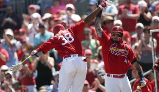 St. Louis Cardinals' Jose Martinez (38) celebrates with Yadier Molina (4) after hitting a home run in the fourth inning of a spring training baseball game against the Washington Nationals, Sunday, March 18, 2018, in Jupiter, Fla. (AP Photo/John Bazemore)