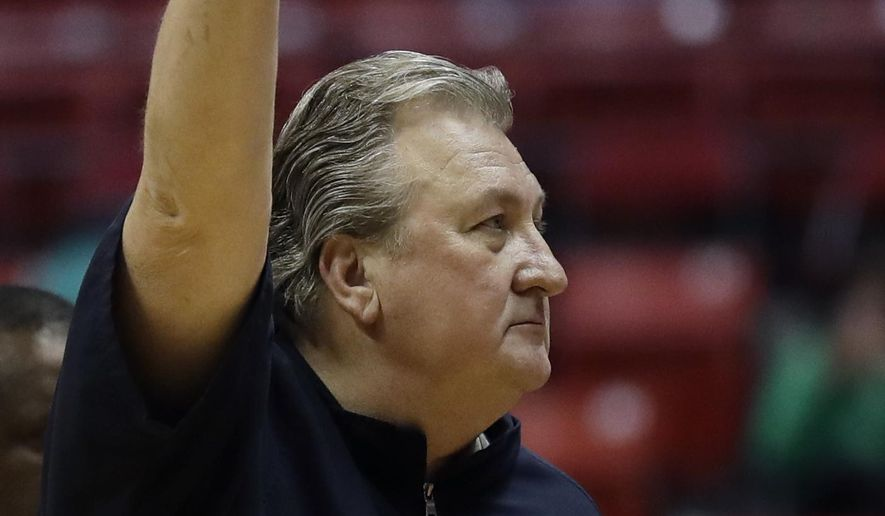West Virginia head coach Bob Huggins reacts after defeating Marshall in a second-round NCAA college basketball tournament game Sunday, March 18, 2018, in San Diego. West Virginia won 94-71. (AP Photo/Gregory Bull)