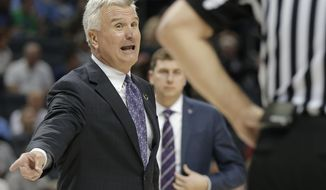 Kansas State coach Bruce Weber argues a call during the second half of a second-round game against UMBC in the NCAA men's college basketball tournament in Charlotte, N.C., Sunday, March 18, 2018. (AP Photo/Bob Leverone)