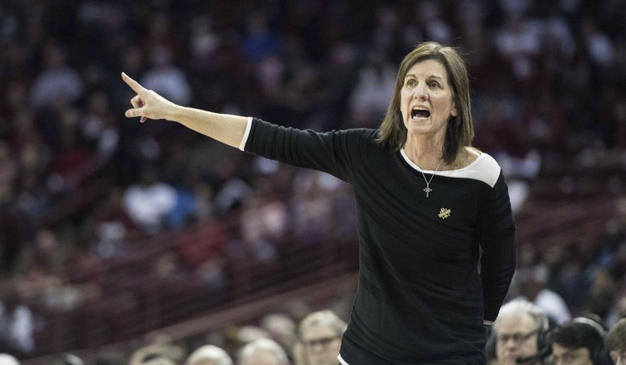 Virginia head coach Joanne Boyle communicates with players during the first half of a second-round game of the NCAA women's college basketball tournament, Sunday, March 18, 2018, in Columbia, S.C. South Carolina defeated Virginia 66-56. (AP Photo/Sean Rayford) **FILE**