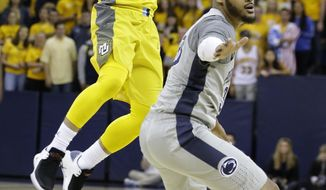 Marquette guard Andrew Rowsey (30) rifles a pass while being defended by Penn State guard Shep Garner (33) during the first half of an NCAA college basketball game in the NIT on Tuesday, March 20, 2018, in Milwaukee. Penn State defeated Marquette 85-80. (Mark Hoffman/Milwaukee Journal-Sentinel via AP)