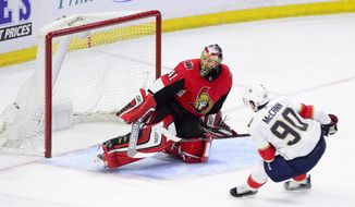 Florida Panthers centre Jared McCann (90) blasts a breakaway shot past Ottawa Senators goaltender Craig Anderson (41) during the second period of NHL hockey action in Ottawa on Tuesday, March 20, 2018. (Sean Kilpatrick/The Canadian Press via AP)