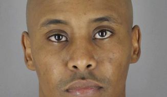 This March 20, 2018 photo provided by the Hennepin County Sheriff's Office in Minneapolis, Minn., shows Minneapolis Police Officer Mohamed Noor, after he turned himself in to the Hennepin County Jail. Noor was charged Tuesday with third-degree murder and second-degree manslaughter in the shooting death of an unarmed Australian woman, Justine Ruszczyk Damond, last July, minutes after she called 911 to report a possible sexual assault behind her home in Minneapolis. (Hennepin County Sheriff's Office via AP)