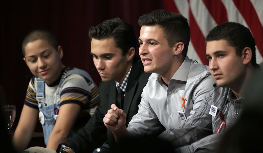 Marjory Stoneman Douglas High School students, and mass shooting survivors, from left, Emma Gonzalez, David Hogg, Cameron Kasky and Alex Wind participate in a panel discussion about guns, Tuesday, March 20, 2018, at Harvard Kennedy School's Institute of Politics, in Cambridge, Mass. The Feb. 14, 2018, attack in Florida killed 17 people, 14 of them students. The students have become vocal advocates for stricter gun laws. (AP Photo/Steven Senne) ** FILE **