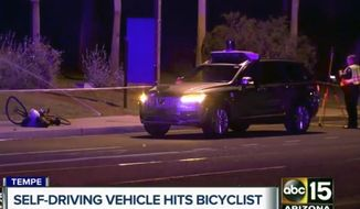 This March 19, 2018, still image taken from video provided by ABC-15, shows investigators at the scene of a fatal accident involving a self driving Uber car on the street in Tempe, Ariz. Police in the city of Tempe said Monday, March 19, 2018, that the vehicle was in autonomous mode with an operator behind the wheel when the woman walking outside of a crosswalk was hit. (ABC-15.com via AP)