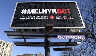 A billboard calling for Ottawa Senators owner Eugene Melnyk to sell the NHL hockey team is seen in Ottawa on Monday, March 19, 2018. (Justin Tang/The Canadian Press via AP)