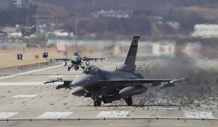 U.S. Air Force F-16 fighter jets land at the Osan U.S. Air Base in Pyeongtaek, South Korea, Tuesday, March 20, 2018. At a potentially pivotal moment of diplomacy with North Korea, the Pentagon said Monday that annual U.S.-South Korean military exercises that had been postponed for the Pyeongchang Winter Olympics will begin April 1. (Hong Gi-won/Yonhap via AP)