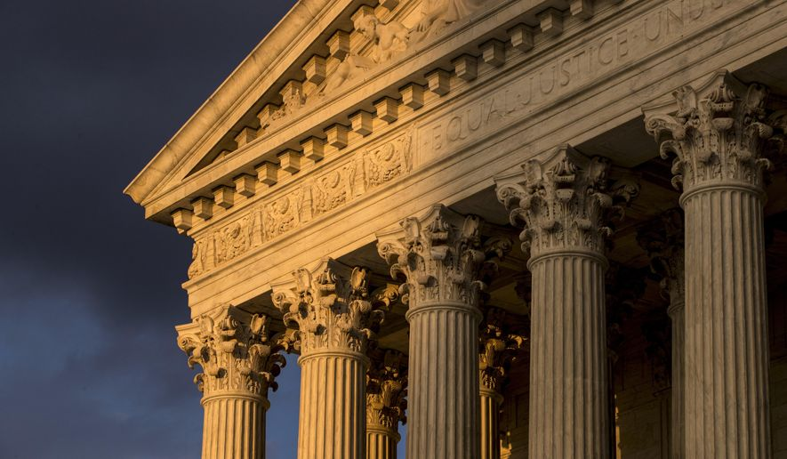 FILE - In this Oct. 10, 2017, file photo, the Supreme Court in Washington is seen at sunset. The Supreme Court is hearing arguments in a free speech fight over California's attempt to regulate anti-abortion crisis pregnancy centers. The case being argued March 20, 2018, involves information required by a state law that the centers must provide clients about the availability of contraception, abortion and pre-natal care, at little or no cost. Centers that are unlicensed also must post a sign that says so.(AP Photo/J. Scott Applewhite, File)