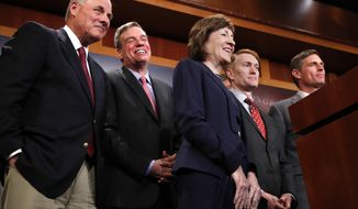 Members of the Senate Intelligence Committee, including Chairman Sen. Richard Burr, R-N.C., left, Vice Chair Sen. Mark Warner, D-Va., Sen. Susan Collins, R-Maine, Sen. James Lankford, R-Okla., and Sen. Martin Heinrich, D-N.M., react as the group declines to answer a question about President Donald Trump, Tuesday, March 20, 2018, on Capitol Hill in Washington. (AP Photo/Jacquelyn Martin)