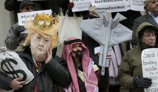 Protesters, some dressed as United States President Donald Trump and Crown Prince Mohammed bin Salman, stand on the steps of City Hall in New York, Tuesday, March 20, 2018. Crown Prince Mohammed bin Salman, son of King Salman and heir to the throne, is opening a marathon tour of the United States with a stop in Washington, where he'll meet Trump on Tuesday. (AP Photo/Seth Wenig)