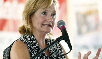 FILE - In this July 27, 2017, file photo Mississippi Commissioner of Agriculture and Commerce Cindy Hyde-Smith speaks at the Neshoba County Fair in Philadelphia, Miss. The state's governor will appoint Hyde-Smith as Mississippi's first female member of Congress to fill the Senate vacancy that will soon be created when Sen. Thad Cochran retires, three state Republicans told The Associated Press on Tuesday, March 20, 2018. (AP Photo/Rogelio V. Solis, File)