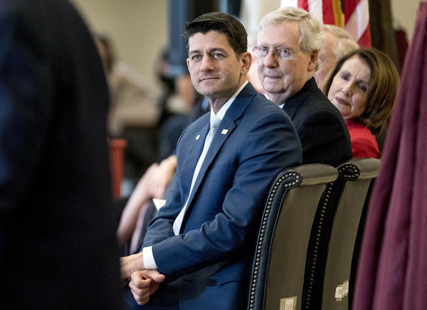 From left, House Speaker Paul Ryan of Wis.,, Senate Majority Leader Mitch McConnell of Ky., and House Minority Leader Nancy Pelosi of Calif. appear for a Congressional Gold Medal Ceremony honoring the Office of Strategic Services in Emancipation Hall on Capitol Hill in Washington, Wednesday, March 21, 2018. (AP Photo/Andrew Harnik)
