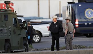Officials investigate the scene where a suspect in a series of bombing attacks in Austin blew himself up early Wednesday as authorities closed in, Wednesday, March 21, 2018, in Round Rock, Texas. (AP Photo/Eric Gay)
