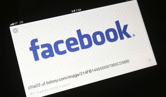 The Facebook logo is seen on a smartphone in Ilsan, South Korea, Wednesday, March 21, 2018. (AP Photo/Ahn Young-joon)