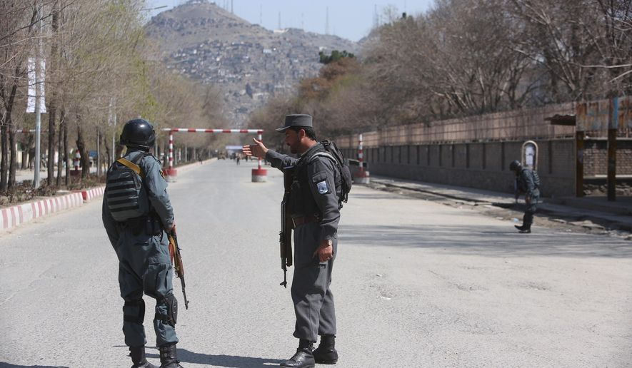 Police patrol the streets after a suicide attack in front of the Kabul university in Kabul, Wednesday, March 21, 2018. Afghan officials are reporting a large explosion on the road to a Shiite shrine in the capital, where people had gathered to mark the Persian new year. (AP Photo/ Rahmat Gul)