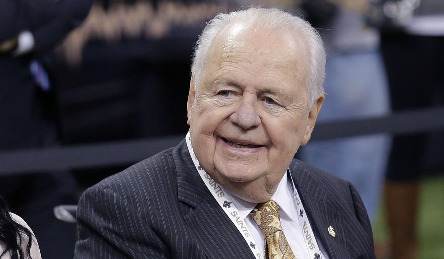 FILE - In this Oct. 26, 2014, file photo, New Orleans Saints owner Tom Benson sits on the sideline before the team's NFL football game against the Green Bay Packers in New Orleans. Visitation for Benson, who died last week, takes place Wednesday and Thursday at Notre Dame Seminary in New Orleans. A private funeral service is set for noon Friday at St. Louis Cathedral in the French Quarter. (AP Photo/Bill Haber, File)
