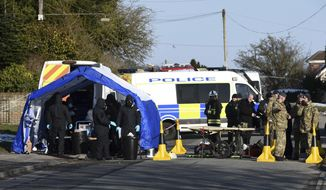 """Various police, Army and other emergency service personal attend a scene in Durrington near Salisbury, England, Monday March 19, 2018, as a car is taken away for further investigation into the suspected nerve agent attack on Russian double agent Sergei Skripal and his daughter Yulia. NATO's secretary-general Jens Stoltenberg said Monday that  """"all 29 NATO allies stand united,"""" with Britain amid diplomatic tensions with Russia over the March 4 poisoning of the ex-spy in an English city. (Ben Birchall/PA via AP)"""