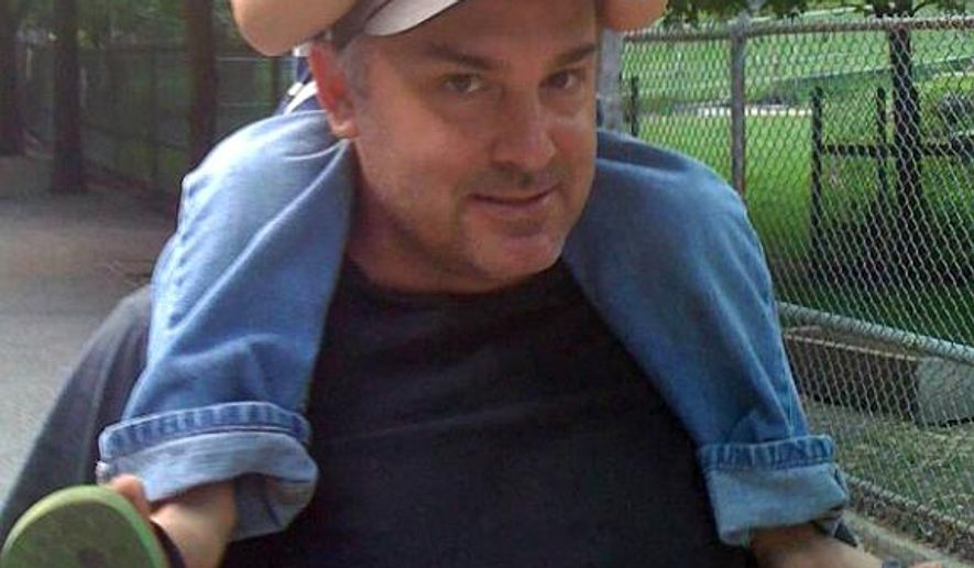 This undated photo provided by Judi Riley shows her brother Jon Riley carrying his nephew at High Park Zoo in Toronto, Canada. Jon went missing in 2013 while on a trip to Toronto but there were no leads until the 2018 arrest of alleged serial killer Bruce McArthur who has been charged with six deaths. Jon Riley's case is still open. (Judi Riley via AP)