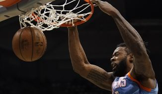 LA Clippers' DeAndre Jordan dunks during the first half of an NBA basketball game against the Milwaukee Bucks Wednesday, March 21, 2018, in Milwaukee. (AP Photo/Morry Gash)