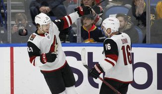 Arizona Coyotes Dylan Strome (20) and Max Domi (16) celebrate a goal during the first period of the team's NHL hockey game against the Buffalo Sabres on Wednesday, March 21, 2018, in Buffalo, N.Y. (AP Photo/Jeffrey T. Barnes)