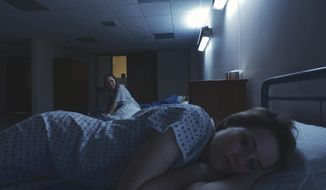 "This image released by Bleecker Street shows Juno temple, background, and Claire Foy in a scene from ""Unsane."" (Bleecker Street via AP)"