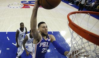 Philadelphia 76ers' Ben Simmons (25) goes up for a dunk during the first half of the team's NBA basketball game against the Memphis Grizzlies, Wednesday, March 21, 2018, in Philadelphia. (AP Photo/Matt Slocum)