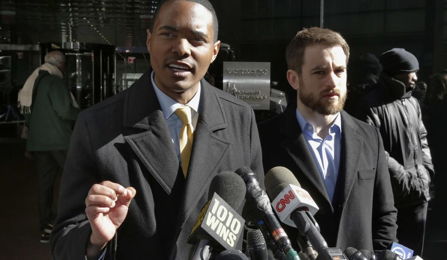 FILE - In this Monday, March 19, 2018, file photo, New York City Council Member Ritchie Torres, left, and Housing Rights Initiative Executive Director Aaron Carr address a news conference outside Kushner Companies headquarters in New York. The pair was calling for an investigation into a report by The Associated Press and a tenants' rights watchdog that Jared Kushner's family real estate company routinely filed false paperwork declaring it had zero rent-regulated tenants in dozens of buildings it owned in New York when it actually had hundreds. New York City's buildings regulator launched investigations at more than a dozen Kushner Cos. properties Wednesday following the AP report. (AP Photo/Richard Drew, File)