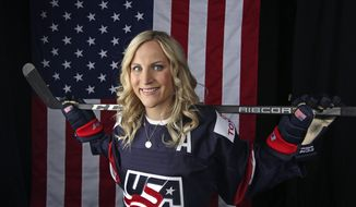 FILE - In this Sept. 26, 2017, file photo, United States women's hockey player Monique Lamoureux-Morando poses for a portrait at the 2017 Team USA Media Summit in Park City, Utah. Gold-medalist Monique Lamoureux-Morando will make her debut as a NHL Network studio analyst on Friday, the network announced Wednesday, march 21, 2018.  (AP Photo/Rick Bowmer, File)